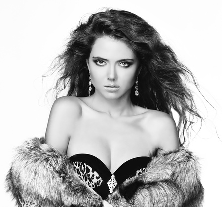 Fashion brunette woman in fur coat with evening make-up  Jewelry and Beauty   photo