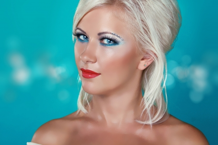 Glamour portrait of beautiful woman model with makeup and blond hairstyle. Stock Photo - 15570720