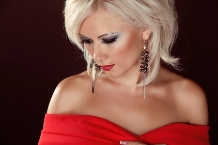 Sensual blond woman elegant portrait, with evening make-up. Jewelry and Beauty. Stock Photo - 15570721