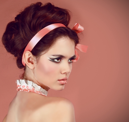 Beautiful woman with make-up and hair style over pink Stock Photo - 15570713