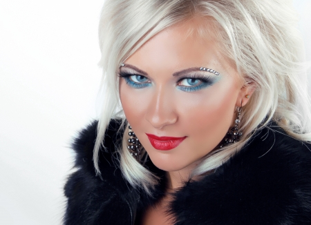 Fashion Blond Girl. Blonde Woman with Blue Eyes.  photo
