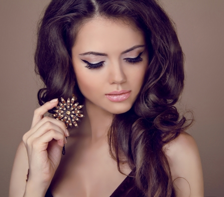 beautiful girl face: Beautiful woman with curly hair and evening make-up. Jewelry and Beauty.   Stock Photo