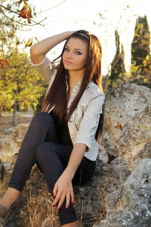 Young brunette woman, outdoors portrait photo