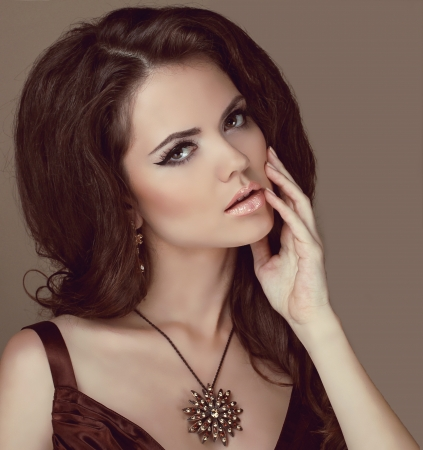 beige lips: Beautiful woman with curly hair and evening make-up. Jewelry and Beauty. Fashion. Perfect Skin. Skincare.