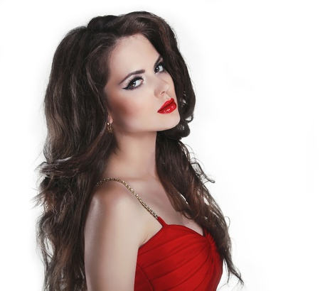 Portrait of beautiful brunette woman with red lips and curly hairs in dress