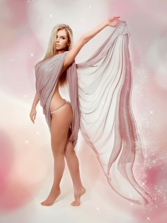 dress blowing in the wind: Fairy. Beautiful Blond Girl in Blowing Dress Flying Stock Photo