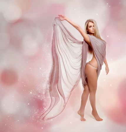 Fairy. Beautiful Blond Girl in Blowing Dress Flying photo