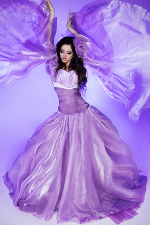 purple dress: Fairy. Beautiful Girl in Blowing Dress. Fashion Art photo Stock Photo