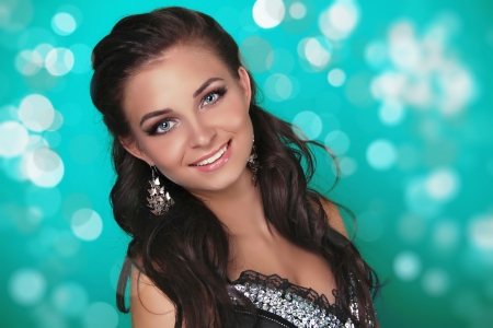 Young beautiful teen with smile, green holiday light background Stock Photo - 16143301