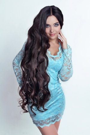 brown hair blue eyes: Beautiful Brunette Girl. Healthy Long Curly Hair. Lady in blue dress