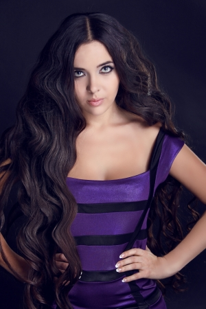 Photo of young beautiful woman with magnificent long hair