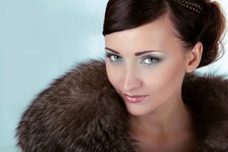 Woman with blue eyes, Winter Girl in Luxury Fur Coat photo
