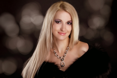 Beautiful woman with blond hair and evening make-up. Jewelry and Beauty. Fashion art photo Stock Photo - 16664776