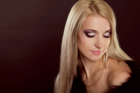 Beautiful woman with blond hair and evening make-up. Jewelry and Beauty. Fashion art photo Stock Photo - 16664762