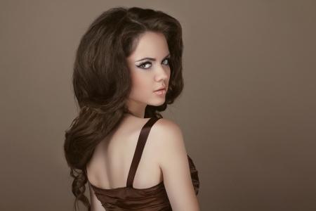 Elegant Woman with beauty long brown hair posing at studio Stock Photo - 16732266