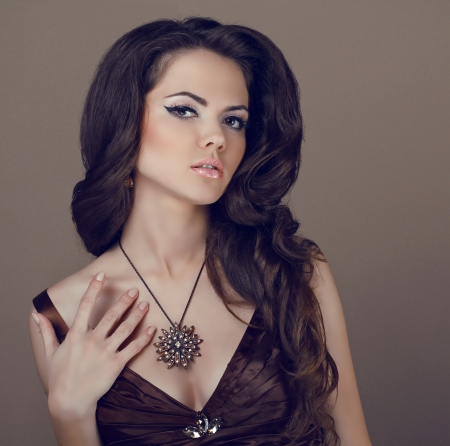 Brown Hair Styling. Beautiful Woman with Healthy Long Hair photo