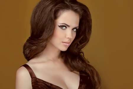 Glamour portrait of beautiful woman model with makeup and romantic hairstyle.  photo
