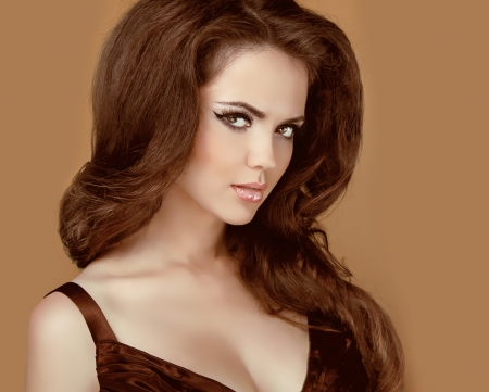 Portrait of Beautiful Woman with Brown Hair Styling.  photo