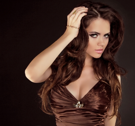Brown Hair. Beautiful Woman with Healthy Long Curly Hair Stock Photo - 16732263