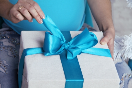 open present: Opening gift boxes with blue bows and ribbons.  Stock Photo