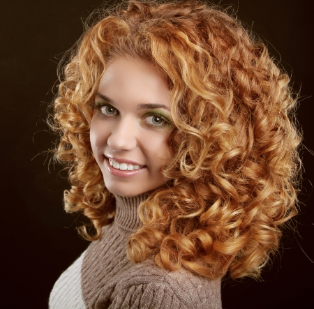 Healthy Curly Hair. Attractive smiling woman portrait on black background Stock Photo - 17260652