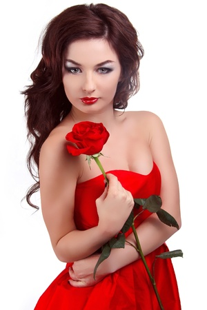 Portrait of beautiful woman with beauty long brown hair holding red rose Stock Photo - 17314424