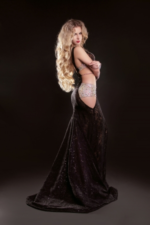 cleavage: Portrait of young elegant girl with smart fair hair in long dress