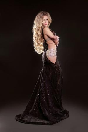 avantegarde: Portrait of young elegant girl with smart fair hair in long dress