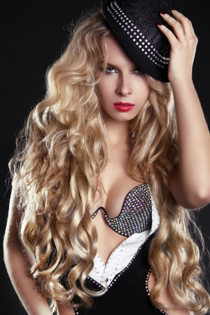 long red hair woman: Blond woman with long beautiful hair and red lips in hat.