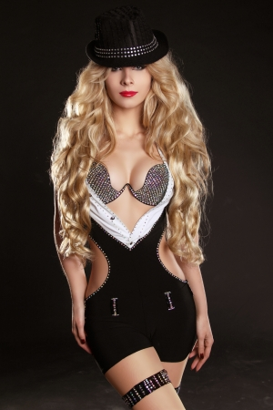 Blond woman with long beautiful hair and red lips in hat. photo