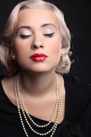 Retro woman portrait with red lips and blond hairstyle  photo