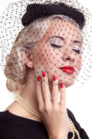 Blond Woman with bright make up and red nails in hat over white  photo