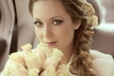 hair bow: Beautiful bride woman portrait with bridal bouquet posing in her wedding day