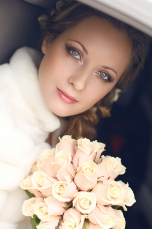 bridal hair: Beautiful bride woman portrait with bridal bouquet posing in her wedding day