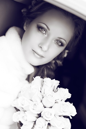 Beautiful bride woman portrait with bridal bouquet posing in her wedding day photo