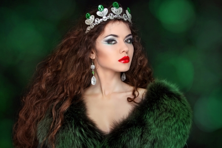 Beautiful woman in luxury fur coat  Jewelry and Beauty  Fashion  photo