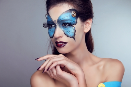 Fashion Makeup. Butterfly face art woman Portrait. Stock Photo - 17852085