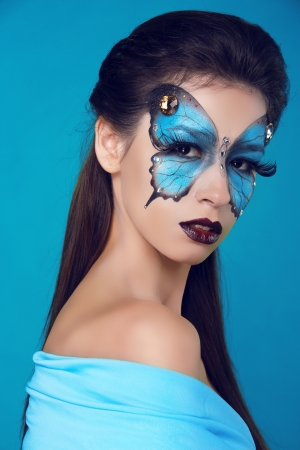Fashion woman Portrait. Butterfly makeup,  face art make up Stock Photo - 17852061