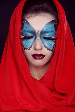 kerchief: Fashion Make up. Butterfly makeup on face beautiful woman. Art Portrait.