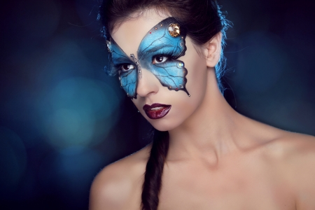 Fashion Make up. Butterfly makeup on face beautiful woman. Art Portrait. photo