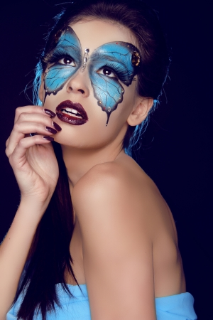 Fashion woman Portrait. Butterfly makeup,  face art make up Stock Photo - 17852086