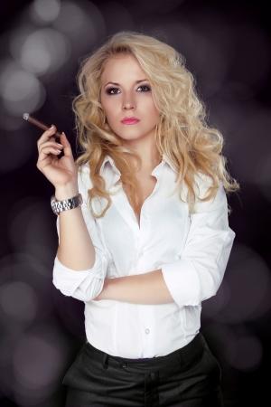 cigar smoking woman: Sexy smoking beautiful woman cigar closeup studio shot