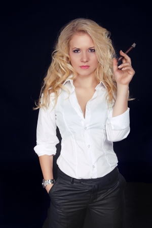 Woman with Cigar Exhaling Smoke on a Dark Background, Men style photo