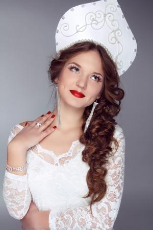 kokoshnik: Russian Beauty. Attractive female wearing in kokoshnik. Womans headdress in old Russia Stock Photo