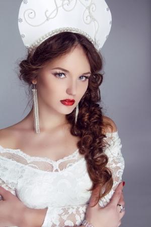 russian woman: Beautiful woman with kokoshnik. Jewelry and Beauty. Fashion art Russian photo
