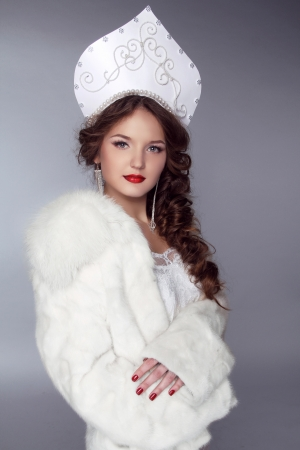 Russian Beauty. Attractive female wearing in kokoshnik. Womans headdress in old Russia Stock Photo
