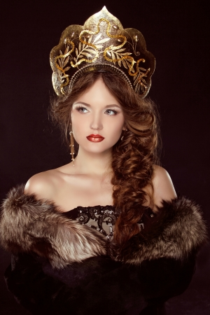 Russian Beauty. Attractive female wearing in kokoshnik. Woman's headdress in old Russia photo