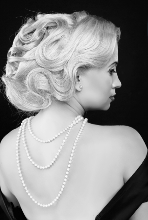 Wavy Hairstyle. Jewelry And Beauty. Fashion Art Photo. Retro Woman photo