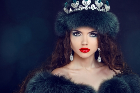 Jewelry and Beauty. Beautiful  woman model wearing in fur coat.  photo