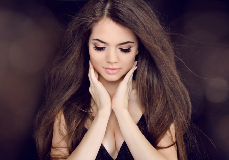 Beautiful woman with long brown hair. Fashion long hairstyles Stock Photo - 18184959